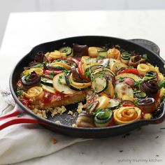 Layered Ratatouille Vegetables on a Bed of Skillet Polenta and Tomato Sauce - This ratatouille recipe is a delicious way to use summer garden vegetables like zucchini, yellow squash, eggplant, and bell peppers in a comforting vegetarian meal
