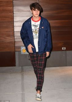 Undercover: Anwar Hadid - pictured on September 14 - was nearly unrecognisable in the soci...