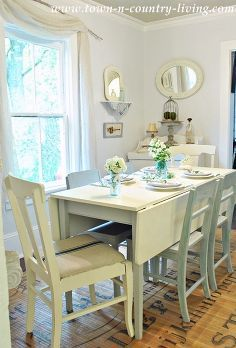 simple tricks for decorating with white, home decor, living room ideas, Use varying shades of white Steam White paint by Laura Ashley has a gray blue undertone and is used on the walls in the dining room Paris Gray chairs and a blue mason jar with flowers add a pop of color for added interest