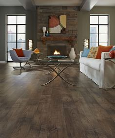 Nice balance of contemporary furniture and a rustic floor! Lovely laminate floors. Saw similar ones at http://www.simiflooring.com/