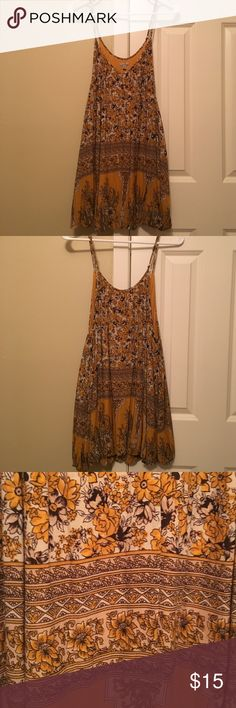 Urban Outfitters summer dress Mustard yellow dress with floral designs and the bottom tucks under a little bit as shown in the last photo Ecote Dresses Mini