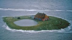 """malformalady: """"Hallig Habel, a farm in the flatlands of North Frisian Islands, Germany, during an extreme high tide. Handbuilt Shelter by Lloyd Kahn Photo credit: Hans Joachim Kürtz from Home Work """" Reisen In Europa, North Sea, Small Island, Far Away, Places To See, The Good Place, Nostalgia, Beautiful Places, Scenery"""