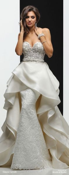 Strapless sweetheart neckline, beaded embroidery draped bodice sheath skirt with detachable wrap draped train.