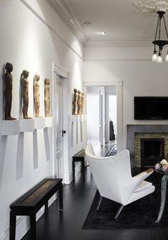 A pair of vintage Hans Wegner Papa Bear armchairs, clad in muslin, occupies the TV room.