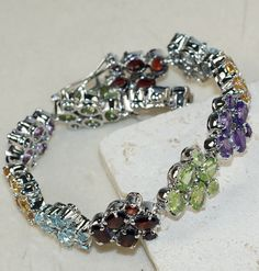 Mixed Faceted Stones bracelet designed and created by Sizzling Silver. Please visit  www.sizzlingsilver.com. Product code: BR-8718