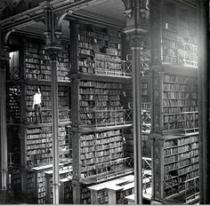 A man browsing for books in Cincinnati's main library. Demolished in 1955