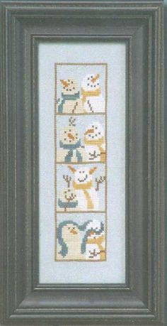 Photo Booth Snowmen cross-stitch kit.  I love the third photo in the strip!