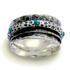 Sterling silver and yellow gold spinner with teal turquoises meditation ring - On the edge. $208.00, via Etsy.