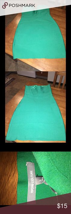 Green Bodycon Strapless Dress By Wow Couture Large Green bandage style Bodycon dress.  Strapless.  Has small amount of padding in breast cup area.  From Wow Couture.  Size large.  Length is 25.75 inches. Good condition.  Important:   All items are freshly laundered as applicable prior to shipping (new items and shoes excluded).  Not all my items are from pet/smoke free homes.  Price is reduced to reflect this!   Thank you for looking! WOW couture Dresses Mini