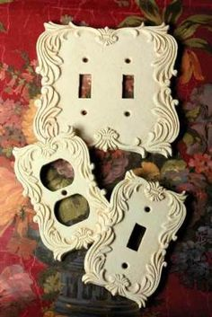 "Outlet Covers Cast from flourished molds, utilitarian decoratives are a welcomed departure from hardware store offerings. Hardware included. Double switch 6 x 6"". Outlet 3 x 5"". Light Switch 3 x 5"". VTC Exclusive! Please Select: Double Switch, #i15849 $12.95 ($20. retail) Outlet, #i15850 $9.95 ($16. retail) Light Switch, #i15851 $9.95 ($16. retail)"