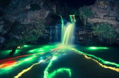 Glow sticks, a waterfall and long exposure