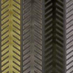 A bold cut velvet print of geometric stripes. A timeless home decor fabric in shades of brown and green.