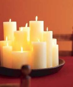 Arrange candles of different heights next to each other for a cozy display.