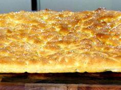 Fococcia. Anne Burrell's recipe makes a large sheet pan. Wonderful.