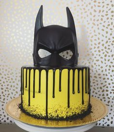 Batman cake : yellow and black Batman cake with ganache drip by Sarah PettyYou can find Batman cakes and more on our website.Batman cake : yellow a. Lego Batman Cakes, Batman Birthday Cakes, Superhero Birthday Party, 5th Birthday, Lego Batman Party, Birthday Ideas, Birthday Parties, Superhero Cake, Themed Cakes