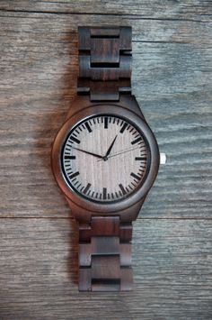 66ccb1a0ce7 This Wood In Philosophy Watch is precision crafted from Black Walnut Wood  and features a strap