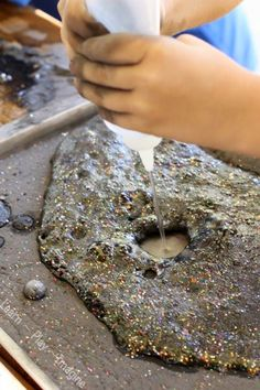 Erupting moon dust sensory tray - a prewriting activity that pops, fizzes, and bubbles!