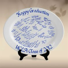 "Signature Graduation Platter. Commemorate a Special Graduation Event! When you order this unique alternative to a traditional guest book, we will ship you an 11"" x 17"" paper template for your guests to sign. As soon as the template is filled with your guest's well wishes, send it back to us. We will transform your signed paper template to a piece of digital film. The film is used to make an exact replica of your signatures using ceramic glazes. Then we transfer"