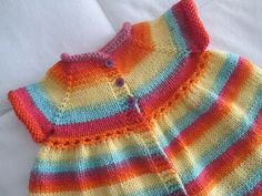 Ravelry: Project Gallery for Sparkly Flouncy Baby Cardi pattern by Sue Caldwell