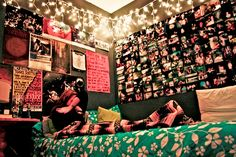 Love the wall of pictures and the christmas lights