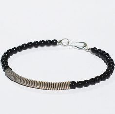 Guitar String Bracelet Upcycled Silver and Black Beaded by Tanith on Etsy  $24.00