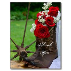 Customize the charming Rustic Roses Country Wedding Thank You Postcard with your own personal message of thanks, gratitude and appreciation. Suitable to use for gifts received after a casual yet classy rural country farm, rustic barn, ranch or western shower, engagement party or wedding theme. This pretty custom shabby chic thank you postcard features a floral photograph of brown leather cowboy boots filled with a bouquet of red rose and white baby's breath flower blossoms and a white bridal…