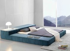 Opaq Contemporary Bed Frame - Modern bedroom furniture. This Opaq Contemporary Bed Frame brings an ultra modern and refreshing influence to your home decor. Features: Extra wide frame & headboard Innovative styling Finish: soft microfiber Fabric color: aqua blue; more options available Inner frame: constructed of kiln-dried hardwood. Super soft and smart design side frame for working on your tablet, laptop  or a perfect place for your pooch to curl up on at night.
