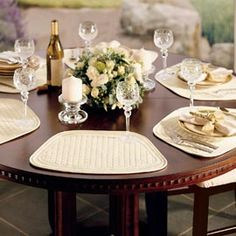 Easily fit a crowd around a round table with these tapered placemats and napkins...and isn't this table setting beautiful? Solutions.com #Dining #Entertaining