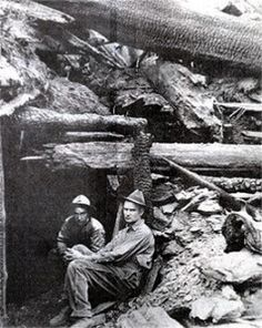 Ed Pulaski, brave Forest Service employee, outside the mineshaft that saved him and his men during the Big Burn of August 1910.