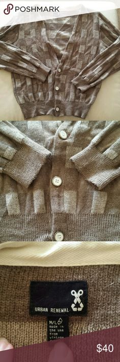 """UO Urban Renewal Men's Hipster Vtg Cardigan M/L Urban Renewal takes vintage clothing and upcycles it into trendy hip clothing.  This sweater is wool. It was reconstructed into a low V 3 button cardigan reinforced with canvas trim.  It is marked a size M/L. Urban Outfitters is the only store to carry this brand. It is tan and brown in a reverse knit. It is medium weight knit.  There is no material content label, but it feels like wool. Measurements taken flat and when buttoned. Shoulders 20""""…"""