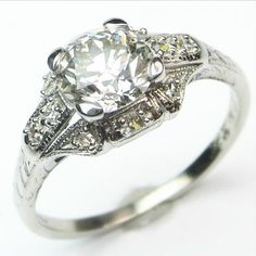 Deco Semi-Panel: A beautiful, bright antique diamond gets just the right amount of support in this graceful Art Deco ring. Ca.1925.  Maloys.com