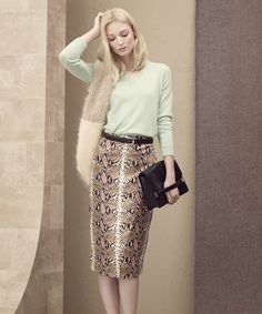 Soft pastel knitwear paired with a snake print skirt creates a cool retro look.  M&S AW15.