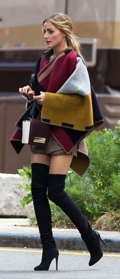 Olivia Palermo looking uber stylish in this Burberry poncho with tall over the knee boots. Recreate this look for less with the Ashanti Brazil Ethnic Print Knitwear collection.