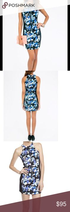 Stylestalker Blue Floral Dress This edgy mini has a racer front and back with a high neck and front zipper in a slimming blue floral and black color block. Hand wash cold and lay flat to dry. 97% cotton 3% spandex Stylestalker Dresses Mini