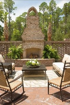 Although our brick fireplaces are considerably bigger we just love this outdoor entertaining space! The brick lattice wall somewhat closes the area to make it feel more cozy and secure. http://www.arnoldmasonryandlandscape.com/service-areas/  #Brick #Fireplace #Contractor #Company #Georgia #Brick_Fireplace_Contractor_Company_Georgia #Brick_Fireplace_Contractor_Company_Georgia