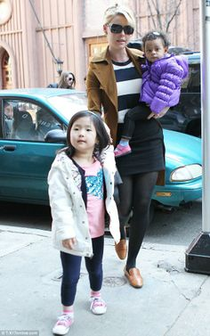 Cute as can be: The 35-year-old held hands with Naleigh while carrying little Adalaide in her free arm