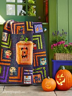 Turn your home into a haunted house with Halloween quilts featuring novelty prints, fall colors, and spooky motifs. Halloween Candy Crafts, Halloween Projects, Spirit Halloween, Fall Halloween, Halloween Ideas, Halloween Quilt Patterns, Halloween Quilts, Halloween Blocks, All People Quilt