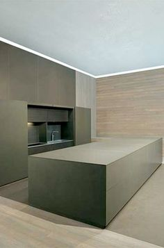 Minimal design, concrete doors and kitchen island by Mk Cucine