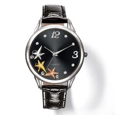 """Round faced silvertone watch with floating star and rhinestone charms, and a patent-leatherlike strap.· Band: 9"""" L x 5/8"""" W with buckle closure· Battery: Replaceable SR626SW· Movement: Quartz- PC21J· Imported Paula Abdul is an award-winning, singer-songwriter, dancer, choreographer and television personality."""