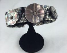 Embellished Pine Needle Basket by Marcie Stone 2019 | Etsy Craft Museum, Pine Needle Baskets, Pine Needles, Button Jewellery, Jewelry, Seed Beads, Jasper, Cuff Bracelets, Glass Beads