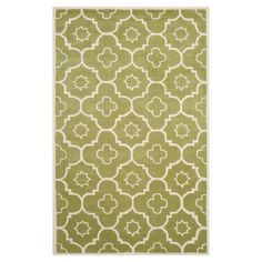 Handmade wool rug with a concentric quatrefoil motif.   Product: RugConstruction Material: WoolColor: