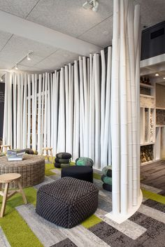 Interpreting #nature stimulates our senses, and ultimately can influence what we create. The more we internalize the idea of natural inspiration, the more sophisticated the result becomes. Green, light grey and dark grey floors in an office collaboration space with bamboo structures. The commercial interiors resemble a jungle or rain forest. The nature inspired interiors and the open office space encourages interaction and drives creativity. #IFinHumanNature #design