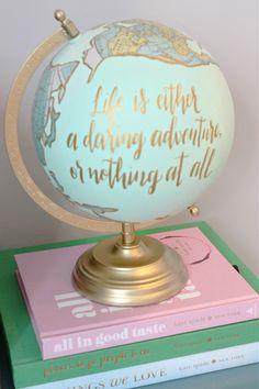 """hand painted globe with quote: """"Life is either a daring adventure or nothing at all"""""""