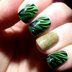 My St. Paddys day nails! #nails #nailart #green #sparkly #zebraprint