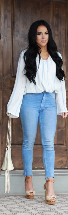 Platforms & Blouses on Sarah and Elizabeth. Cream Fringe crossbody purse, striped white/blue faux wrap blouse witht these cute and affordable high waisted jeans. Casual & Classy day look. Off black 1b hair beach waves