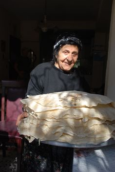 Wow. Kurdish Flatbreads. Usually just water and flour, but they're GIANT! Yummy. And they make them on an awesome griddle--it's the size of a pizza stone or larger.