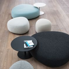 Kipu Ottomans on wood floor, 51.25 x 14.25 in black and cloud blue with Brio Low Tables, also from LaPalma