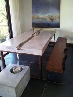 Concrete River Table and Metal Wall Art