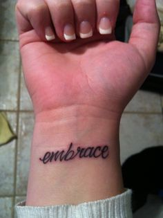 "My sixth tattoo. "" Embrace"" . The artist messed it up and didn't make the entire word the same thickness."