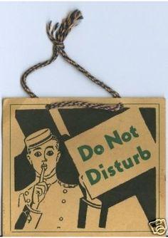 Vintage bellboy Do Not Disturb door sign, via designscouting